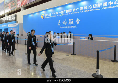 (190423) -- BEIJING, April 23, 2019 (Xinhua) -- Staff members walk pass the Information Desk of the Media Service Area in the Media Center for the second Belt and Road Forum for International Cooperation in Beijing, capital of China, on April 23, 2019. The media center started trial operation at the China National Convention Center in Beijing Tuesday. More than 4,100 journalists, including 1,600 from overseas, have registered to cover the second Belt and Road Forum for International Cooperation to be held from April 25 to 27 in Beijing. (Xinhua/Li He) - Stock Image