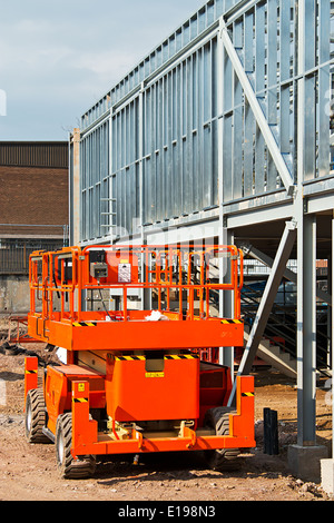 plant hire cherry picker increasingly used on construction sites for health and safety compliance - Stock Image