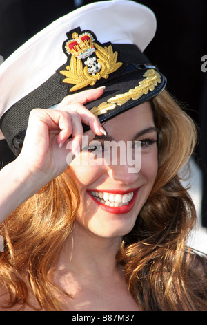 Kelly Brook model and actress aboard HMS Westminster posing with the captains hat - Stock Image