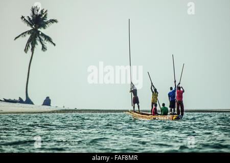 Fishing boat approaching Nyangai Island, in the Turtle Islands, Sierra Leone, West Africa. - Stock Image