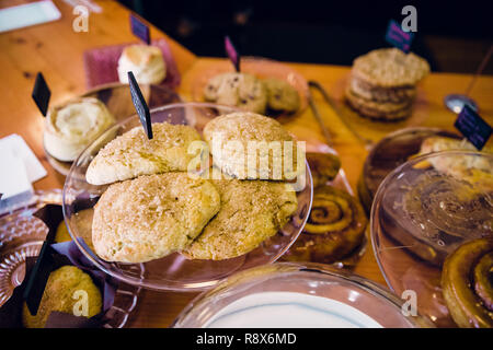 Handmade Scones at Coffee Shop Featuring Bakery Items - Stock Image