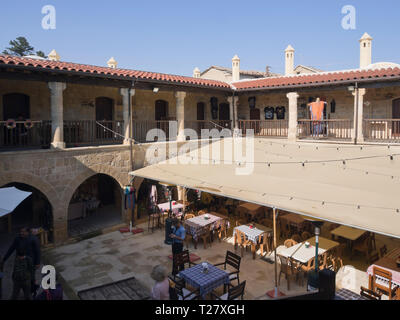 The Kumarcılar Han in the turkish part of Nicosia Cyprus, a historic building with shops and restaurants attracts sightseers and locals - Stock Image