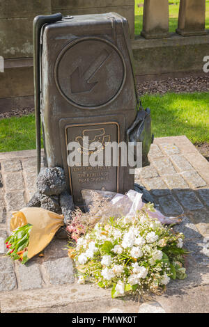 Liverpool St John's Gardens Road Peace Memorial Injured or killed Lives unfulfilled The Reality of Road Crashes bunches flowers teddy bear satchel - Stock Image