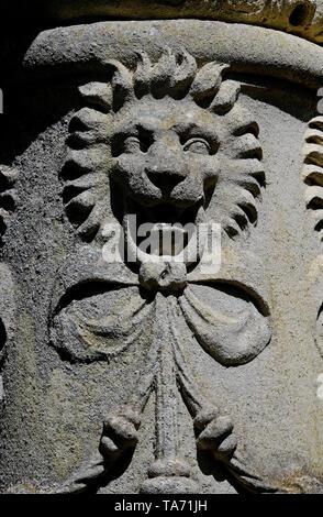 lion motif on old garden urn, houghton hall, norfolk, england - Stock Image
