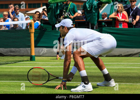 Pakistani tennis player Aisam-ul-Haq Qureshi, on court in men's doubles match, All England Lawn Tennis Club, The Wimbledon Championships 2018 - Stock Image