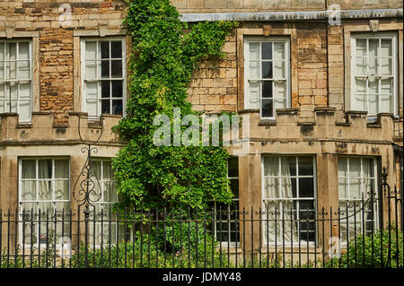 Ornate stone building in the cathedral close in Peterborough - Stock Image