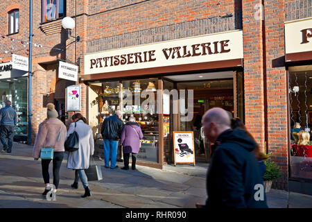 Couple looking at Patisserie Valerie cafe restaurant shop store window display Coppergate York North Yorkshire England UK United Kingdom GB Great Brit - Stock Image