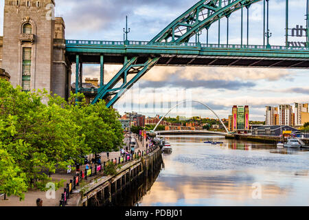 The Tyne riverside with the Tyne Bridge, Millennium Bridge and Baltic Art Gallery at sunset, Newcastle-upon-Tyne and Gateshead, UK. - Stock Image