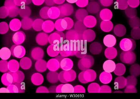 Unfocused abstract colourful bokeh purple background. defocused and blurred many round purple light. - Stock Image