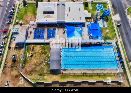Moree Artesian aquatic centre seen from above top down. Swimming pool, spa pools and bath on grounds of aqua park in regional rural town of NSW, Austr - Stock Image