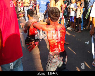 Navotas City, Philippines. 4th Jan, 2012. Back bloodied flagellates seen paraded on the streets of Navotas during Good Friday. Credit: Josefiel Rivera/SOPA Images/ZUMA Wire/Alamy Live News - Stock Image