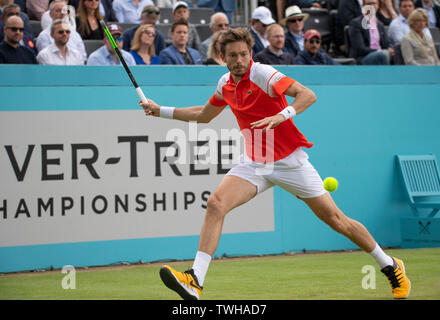 The Queens Club, London, UK. 20th June 2019. Day 4 of The Fever Tree Championships. Number 7 seed Stan Wawrinka (SUI) is knocked out by Nicolas Mahut (FRA) on centre court, Mahut winning 3-6 7-5 7-6 (2) for a place in the quarter finals. Credit: Malcolm Park/Alamy Live News. - Stock Image
