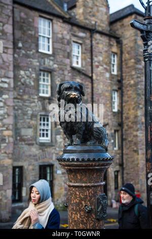 EDINBURGH, SCOTLAND - FEBRUARY 9, 2019 - The statue of Bobby at the corner of Edinburgh's Candlemaker Row and George IV Bridge - Stock Image