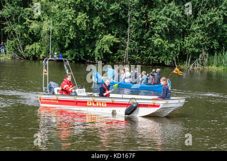 DLRG, sea life rescue, during 'Race' of plastic ducks on river Aller, charity event , Celle, Germany - Stock Image