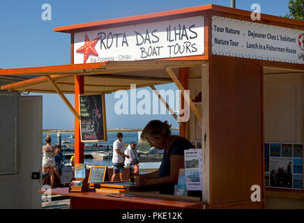 Ticket booth for Boat Tours of Ria Formosa islands and natural park. Harbour, Olhao, Algarve, Portugal - Stock Image