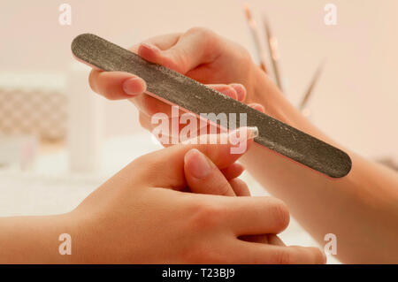 Manicure treatment in nail salon. - Stock Image
