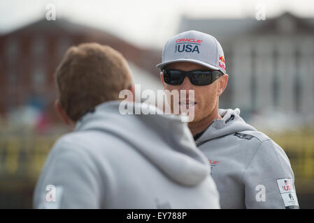 Portsmouth, UK. 23rd July 2015. Team Oracle USA crew talk prior to the opening event of the America's Cup in - Stock Image
