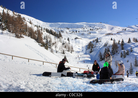 Snowboarders at the Paganella, Trentino, Italy - Stock Image