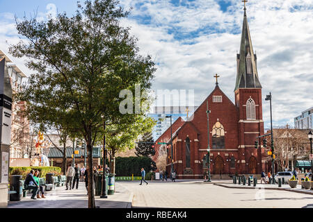 CHARLOTTE, NC, USA-1/8/19: A busy, sunny winter day in uptown, at the corner of Tryon and Levine Ave. of the Arts, near St. Peter's Catholic Church. - Stock Image