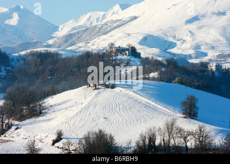 fresh snow covers the foothills of the Sibillini Mountains in Le Marche Italy - Stock Image