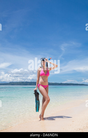 A woman posing in a snorkeling mask. - Stock Image
