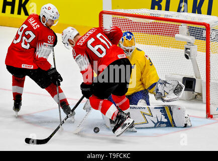 Bratislava, Slovakia. 18th May, 2019. From left hockey players of Switzerland GAETAN HAAS, TRISTAN SCHERWEY and goalie of Sweden HENRIK LUNDQVIST in action during the match Sweden against Switzerland within the 2019 IIHF World Championship in Bratislava, Slovakia, on May 18, 2019. Credit: Vit Simanek/CTK Photo/Alamy Live News - Stock Image