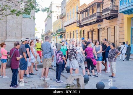 Groups of tourists take in the sights and sounds of the old city of Havana Cuba. - Stock Image