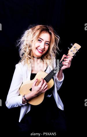 Ukulele, Plucked string instrument, girl playing Ukulele, string instrument, playing Ukulele, Ukulele player, teen Ukulele player, instrument, musical - Stock Image