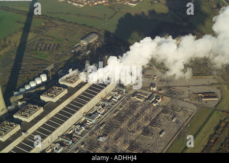Aerial view of stream escaping fom the power station on the Isle of Grain in Kent. Also featured is the 400kV Substation - Stock Image