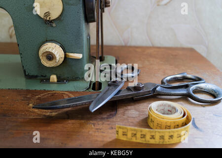 Retro sewing machine in an old house - Stock Image