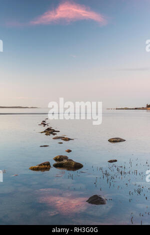 View of stones in sea - Stock Image
