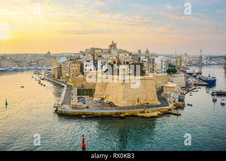 Sunrise at the cruise port and Valletta Grand Harbour on the Mediterranean island of Malta on a warm summer morning - Stock Image