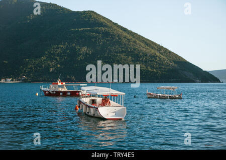 Beautiful view of boats in the sea against the mountains. Natural landscape. Sea transport. - Stock Image
