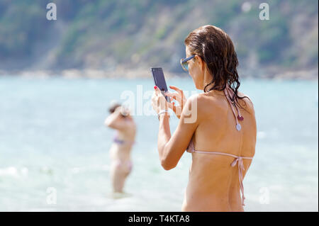 Capri , Italy17 july 2018 : Unidentified name tourist take a picture with a smart phone on the beautiful beach near Naples in Italy - Stock Image