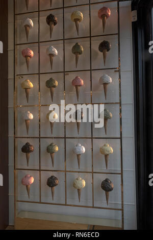 A display of side-lit gelato ice cream cones inside Velchi, a chocolate and gelato shop adjacent to Union Square Park in lower Manhattan, New York Cit. - Stock Image