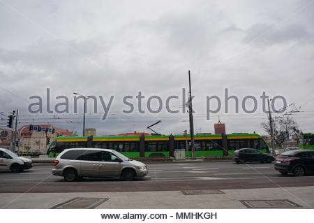 Driving cars and tramway on the Roosevelta street in Poznan, Poland - Stock Image