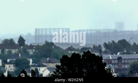 Glasgow, Scotland, UK 9th July, 2019. UK Weather:Heavy rain saw visibility decrease as mist hid the local landmarks behind a grey veil in the city known as Raintown in popular culture as Kelvindale gasometers barely showing with maryhill hidden  in the mist. Credit: Gerard Ferry/ Alamy Live News - Stock Image