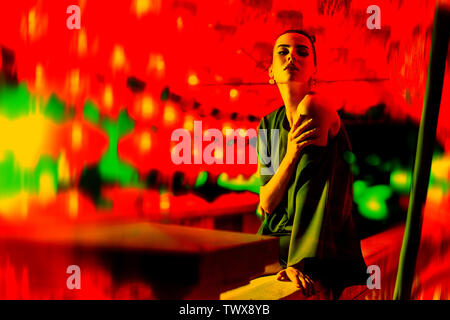 Pretty woman posing in fron of asian ball - lamps - Stock Image