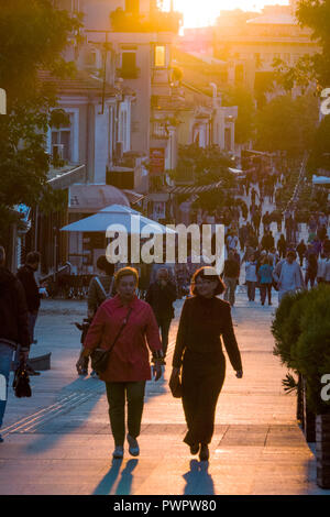 People walking on pedestrian only street in Burgas, Bulgaria - Stock Image