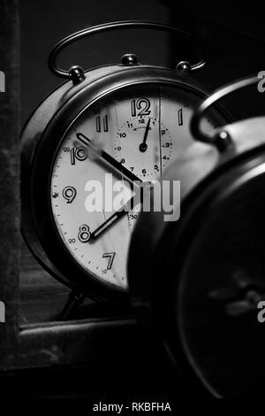 Antique clock reflected in a mirror - Stock Image