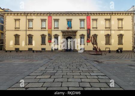 The palace of the Biblioteca & Pinacoteca Ambrosiana art gallery in Milan, neoclassical facade on Piazza Pio XI square - Stock Image