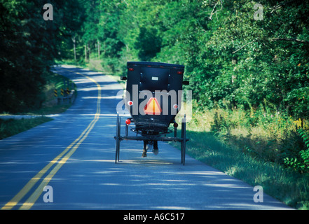 Amish carriage with one horse on highway in mid America in the Midwest United States - Stock Image