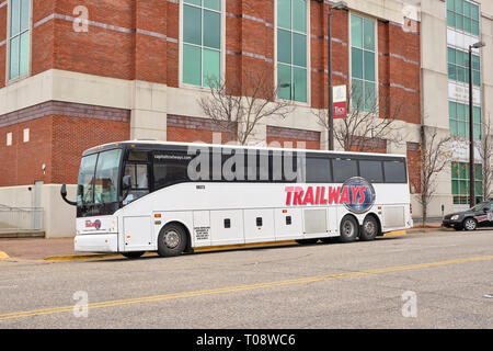 Trailways bus parked idle waiting for passengers at a bus stop in Montgomery Alabama, USA. - Stock Image
