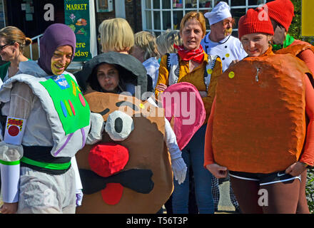 A cartoon characters team taking part in the annual Good Friday Marbles Competition in fancy dress in Battle Market Square, Battle, East Sussex, UK - Stock Image