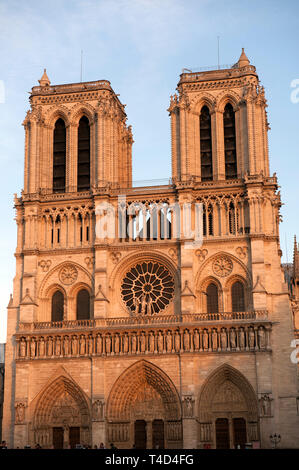 Paris France. Notre Dame Cathedral on the Île de la Cité in the center of Paris. September 2011 Notre Dame meaning 'Our Lady of Paris'), often referred to simply as Notre-Dame, is a medieval Catholic cathedral on the Île de la Cité in the 4th arrondissement of Paris, France.[a] The cathedral is considered to be one of the finest examples of French Gothic architecture. Its innovative use of the rib vault and flying buttress, its enormous and colourful rose windows, and the naturalism and abundance of its sculptural decoration set it apart from the earlier Romanesque style.  The cathedral was be - Stock Image