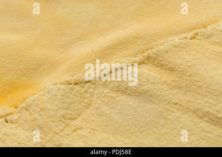 Close-up shot of stitched patchwork Chamois leather car cleaning cloth. - Stock Image