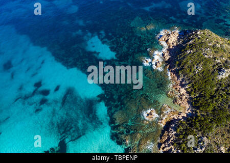 View from above, stunning aerial view of a green rocky coast bathed by a beautiful turquoise sea. Costa Smeralda (Emerald Coast) Sardinia, Italy. - Stock Image