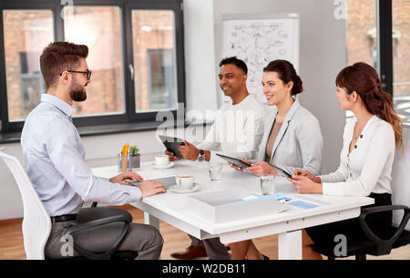 recruiters having job interview with male employee - Stock Image
