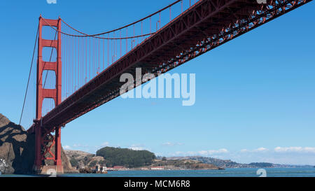 View towards the northern tower of Golden Gate Bridge, from beneath, on the Pacific Ocean side, captured from a ferryboat, San Francisco, California - Stock Image