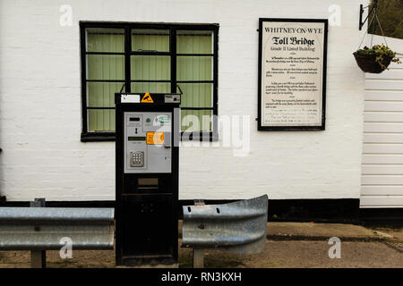 Whitney-on-Wye toll bridge, crossing the River Wye and linking Herefordshire, England and Powys, Wales.  Pay station. - Stock Image